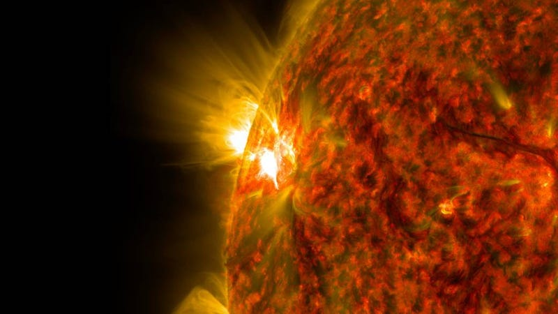 The bright flash of an M-class flare is seen exploding on the left side of the sun in this image from Nov. 5, 2014. (NASA)