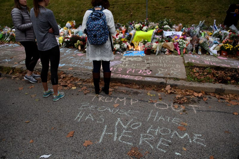 People pause in front of at a memorial for victims of the mass shooting that killed 11 people and wounded 6 at the Tree Of Life Synagogue on October 29, 2018 in Pittsburgh, Pennsylvania.