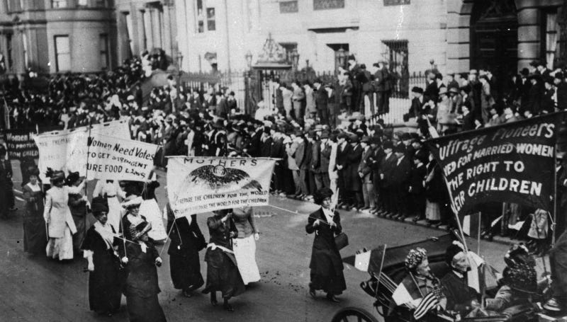 Suffragettes march to the White House in 1917 to demand voting rights. Image via AP Photo.