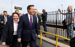Former Prime Minister David Cameron leaves the train station in Devon with Conservative candidate Anne Marie Morris (left) on April 10, 2015, in Dawlish, United Kingdom. (Kirsty Wigglesworth-WPA Pool/Getty Images)