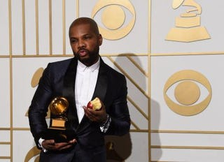 """Kirk Franklin holds his Grammy trophy for """"Wanna Be Happy?"""" in the Grammy press room in Los Angeles on Feb. 15, 2016.MARK RALSTON/AFP/Getty Images"""