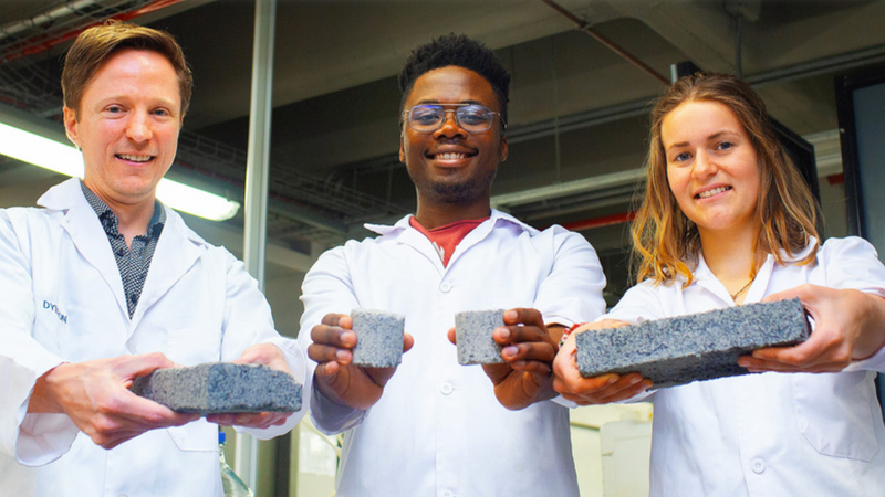 Dyllon Randall and graduate students Vukheta Mukhari and Suzanne Lambert with pee bricks.