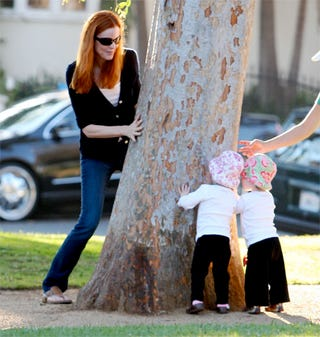 Illustration for article titled Marcia Cross & Kids Play Peek-A-Boo