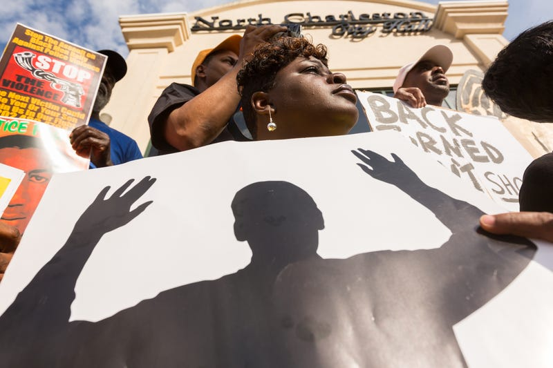 People participate in a rally to protest the death of Walter Scott, outside City Hall on April 8, 2015, in North Charleston, S.C.Richard Ellis/Getty Images