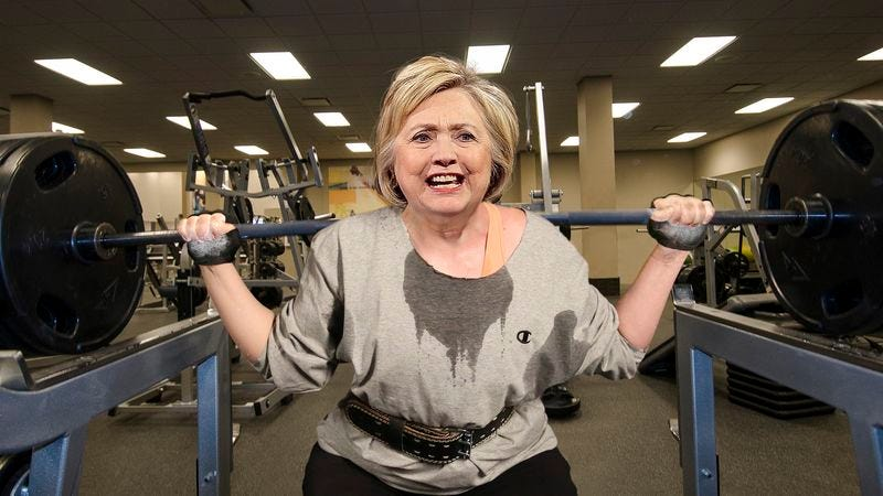 Illustration for article titled Hillary Clinton Sets Personal Single Rep Squat Record While Watching Bernie Sanders On Gym TV