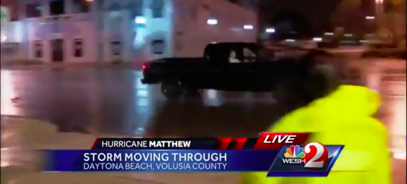 Illustration for article titled Hurricane Matthew Idiot Does Donuts In Front Of Storm And Angry Reporter