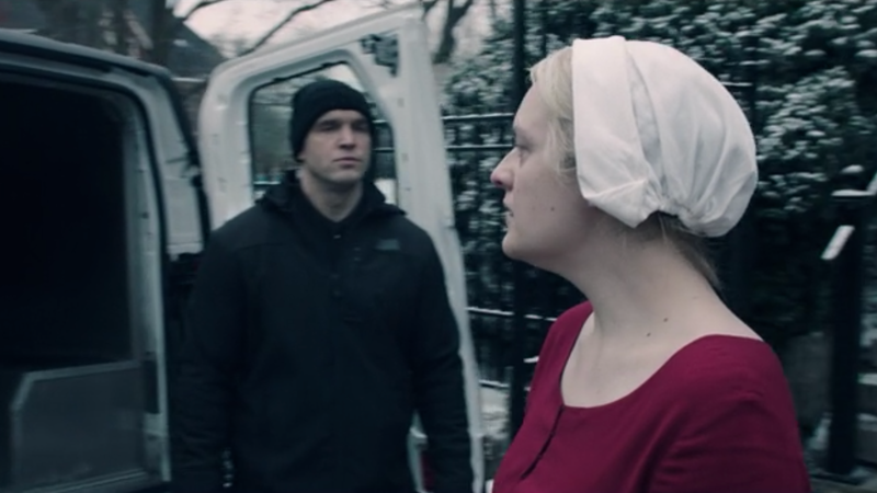 Offred (Elisabeth Moss) heads into a black police van at the end of season one.