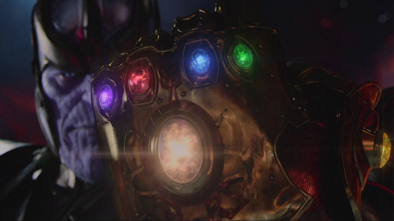 Thanos wielding a fully armed and operational Infinity Gauntlet.