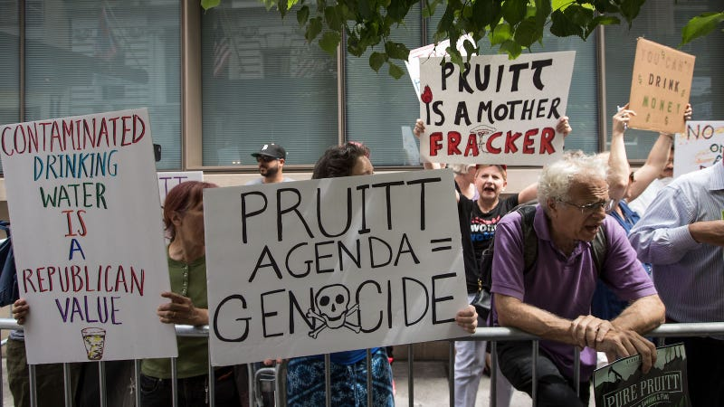Environmental activists protest outside of the Harvard Club where Environmental Protection Agency (EPA) Administrator Scott Pruitt was scheduled to speak, June 20, 2017 in New York City. Image via Getty.