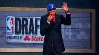 Former Baylor center Isaiah Austin is honored onstage during the 2014 NBA Draft at Barclays Center in Brooklyn, N.Y., June 26, 2014.Mike Stobe/Getty Images