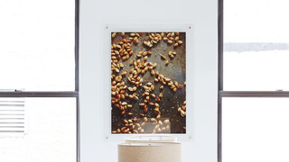 save yourself a ton of money and hang large photos or posters in your own minimalist glass frames