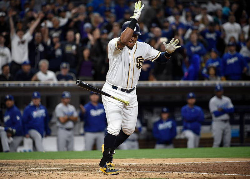 Yangervis Solarte celebrates after drawing the fateful walk. Via Getty Images.