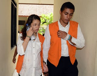 Heather Mack and Tommy Schaefer walk to court for a trial hearing in Denpasar on Indonesia's resort island of Bali on March 11, 2015. (Sonny Tumbelaka/AFP/Getty Images)
