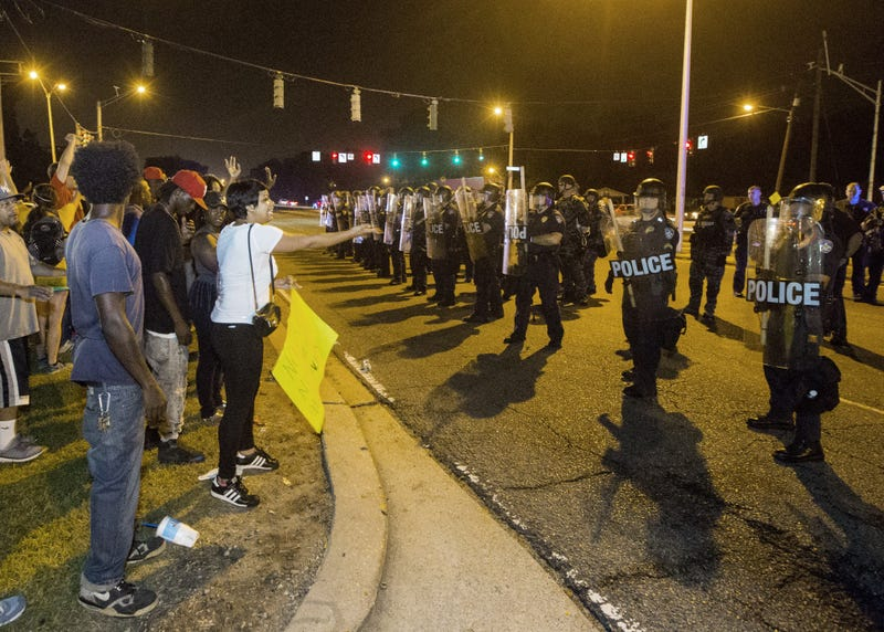 People gather to protest the fatal shooting of Alton Sterling on July 10, 2016, in Baton Rouge, La.Mark Wallheiser/Getty Images