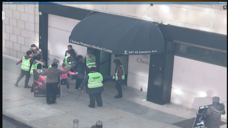 Surveillance videos show anti-abortion protesters standing close to Choices' doors as a woman and child try to enter. Image via Attorney General Eric Schneiderman's office.