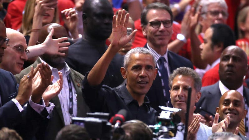 Barack Obama waves to the crowd during Game 2 of the NBA Finals between the Golden State Warriors and the Toronto Raptors at Scotiabank Arena on June 02, 2019, in Toronto.