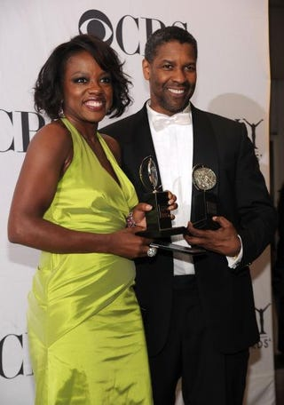 Viola Davis and Denzel Washington pose with their awards at the 64th Annual Tony Awards at the Sports Club/LA on June 13, 2010, in New York City.Bryan Bedder/Getty Images