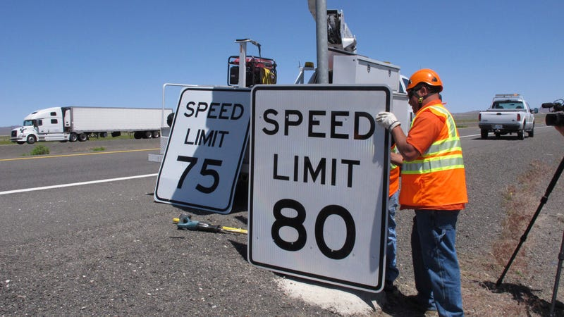 Nevada Department of Transportation crews replace a 75 mph speed limit sign with an 80 mph one Monday, May 8, 2017, along U.S. Interstate 80 near Fernley, Nev., about 40 miles east of Reno. Image credit: Scott Sonner/AP Images
