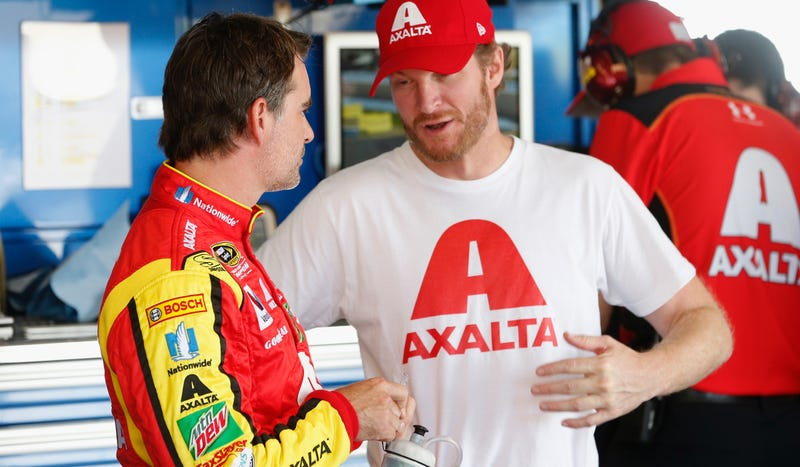 Dale Jr. chats with fill-in driver Jeff Gordon. Photo credit: Getty Images