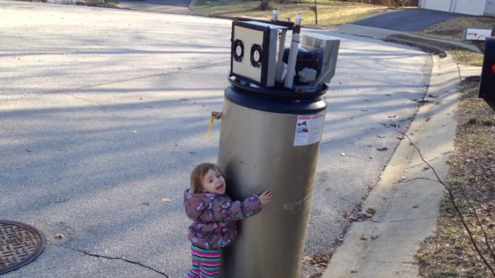 Little girl mistakes water heater for robot, welcomes it to Earth, hugs it, is great
