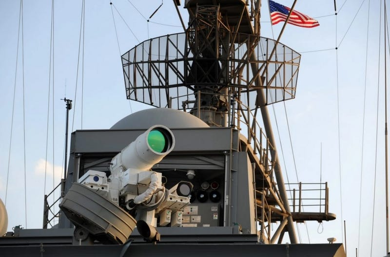 Illustration for article titled Watch The Navy's First Operational Laser Cannon Blow Crap Up