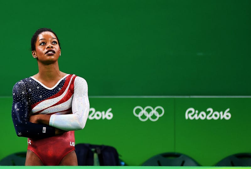 Gabby Douglas waits on the monitor to display the score during women's gymnastics competition at the Olympic Games on Aug. 9, 2016, in Rio de Janeiro.Laurence Griffiths/Getty Images