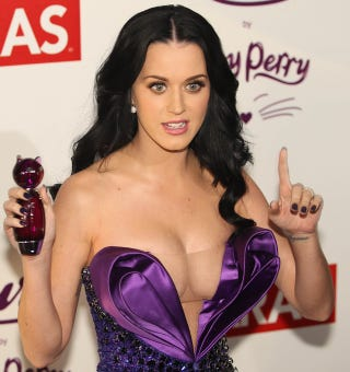 Illustration for article titled Katy Perry Attempts To Distract You From Hideous Dress With Adorable Perfume Bottle