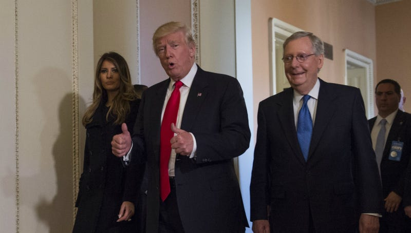 Trump, flanked by his wife Melania and Senate Majority Leader Mitch McConnell of Ky., gives a thumbs-up while walking on Capitol Hill in Washington, Thursday, Nov. 10, 2016, after their meeting. Photo via AP