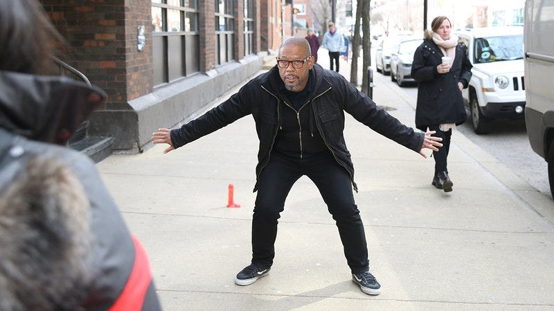 Forest Whitaker blocking people from touching a dildo on the ground.
