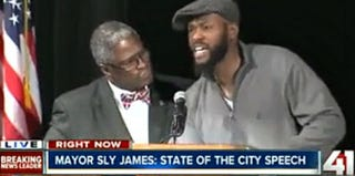 Kansas City, Mo., Mayor Sly James and an unidentified man (Mediaite)