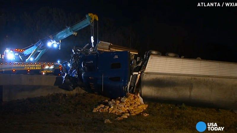 Illustration for article titled 'Ham Jam' Truck Crash Dumps 20 Tons Of Ham Onto Atlanta Freeway