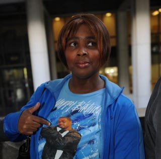 Wanda Johnson, the mother of Oscar Grant, points to his picture as she leaves a March 26, 2010, pretrial hearing at the Criminal Courts Building in Los Angeles for Johannes Mehserle, the former Bay Area Rapid Transit officer charged with murder in Grant's 2009 shooting death.MARK RALSTON/AFP/Getty Images