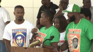 Jamie Foxx (left) and Trayvon Martin's parents, Sybrina Fulton and Tracy MartinWSVN/CNN screenshot