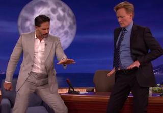Illustration for article titled Here is Joe Manganiello Teaching Conan O'Brien Some Stripper Moves
