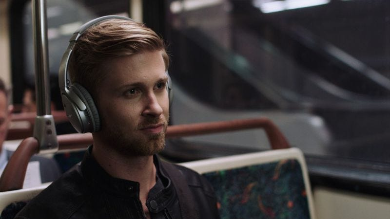 A man enjoying his QuietComfort 35 headphones, which a new lawsuit alleges can record your listening habits. (Photo: Bose)