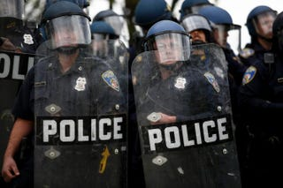 Baltimore police officers in riot gear look toward protesters near Baltimore's Mondawmin Mall April 27, 2015, where young protesters clashed with police following funeral services for Freddie Gray, a young man who died while in police custody.Drew Angerer/Getty Images