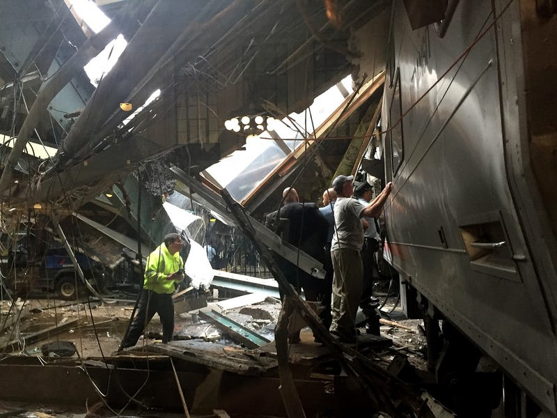 Train personnel survey the NJ Transit train that crashed into the platform at the Hoboken Terminal on Sept. 29, 2016, in New Jersey. Pancho Bernasconi/Getty Images
