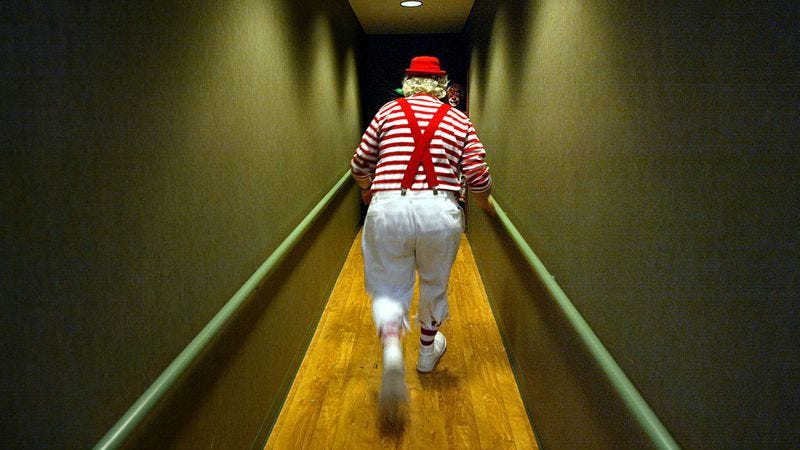 A clown walks down a hallway that is sadly not part of the actual Clown Motel. (Photo:  Mario Tama / Getty Images)