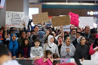 Protesters gather at Dallas-Fort Worth International Airport on Jan. 28, 2017, in Dallas to denounce President Donald Trump's executive order that bans certain immigration. (G. Morty Ortega/Getty Images)