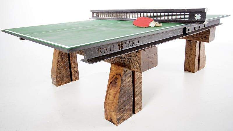 Illustration for article titled Steel and Wood From a Salvaged Railroad Support This Rustic Ping Pong Table