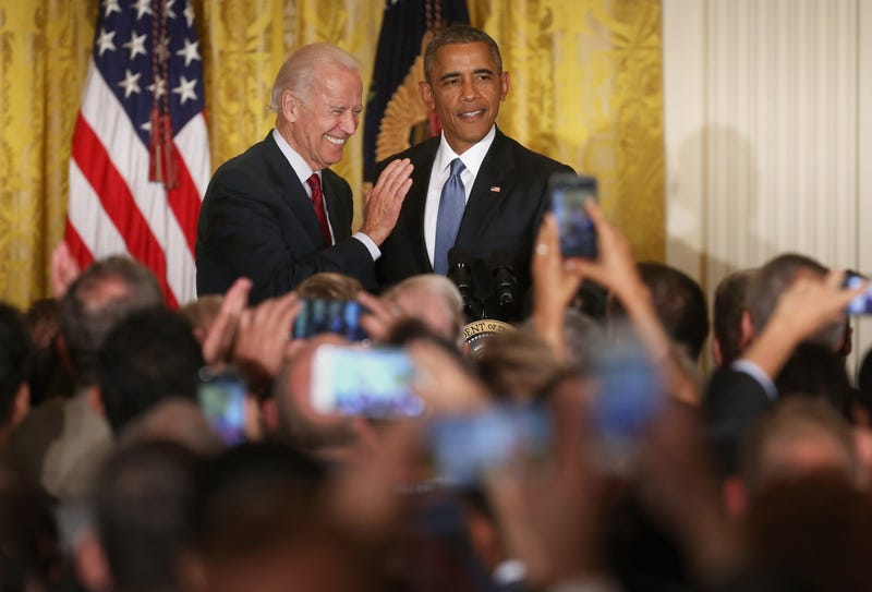 President Barack Obama (right) and Vice President Joe Biden react after a heckler protesting deportations is removed from a reception for LGBT Pride Month in the East Room of the White House on June 24, 2015, in Washington, D.C.Chip Somodevilla/Getty Images