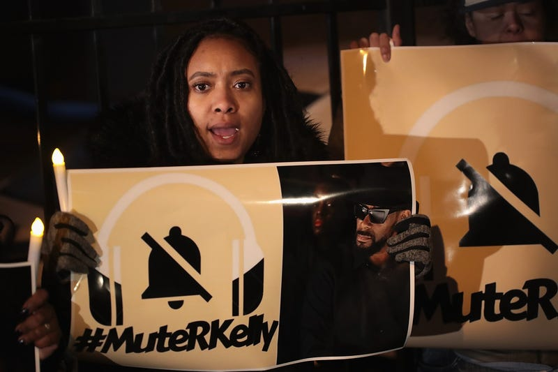 Demonstrators gather near the studio of singer R. Kelly to call for a boycott of his music after allegations of sexual abuse against young girls were raised on the highly-rated Lifetime mini-series 'Surviving R. Kelly' on January 9, 2019 in Chicago, Illinois. Prosecutors in Illinois and Georgia have opened investigations into allegations made against the singer, whose real name is Robert Sylvester Kelly.