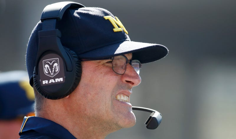 Illustration for article titled Former Michigan Player Tagged Jim Harbaugh In Series Of Vaguely Threatening Tweets [Update]