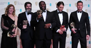Producer Dede Gardner, producer Jeremy Kleiner, director Steve McQueen, producer Anthony Katagas and actor Brad Pitt with their awards for best film for 12 Years a Slave at the British Academy Film Awards, on Feb. 16, 2014CARL COURT/AFP/Getty Images
