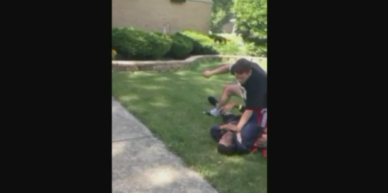 An off-duty Lansing, Ill,. cop was caught on video forcibly pinning down a black teen just for being on his property. (Facebook screenshot)