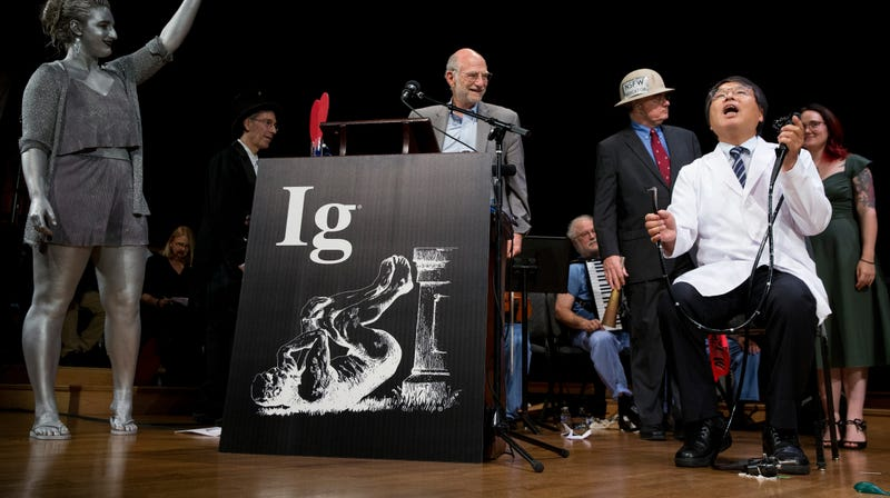 Akira Horiuchi, winner of this year's Ig Nobel for medical education, demonstrates his self-colonoscopy technique during yesterday's award ceremonies at Harvard University.