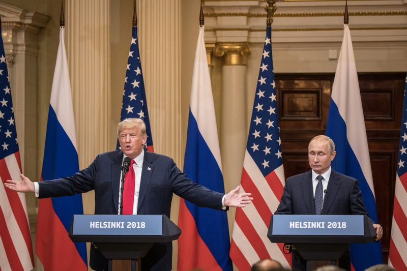 President Donald Trump, left, and Russian President Vladimir Putin answer questions about the 2016 U.S Election collusion during a joint press conference after their summit on July 16, 2018 in Helsinki, Finland.