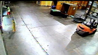 Surveillance video captured from inside the warehouse shows a man reported to be Roderick Phillips leaving with boxes of diapers.  Fox4 Dallas screenshot