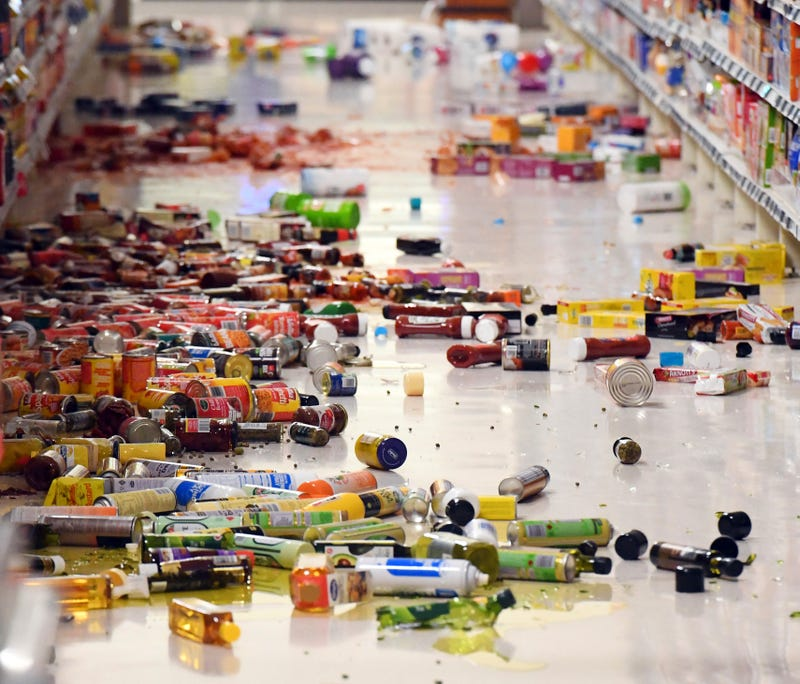 Groceries litter the aisle at the New World, in Miramar area of Wellington. Photo: AP