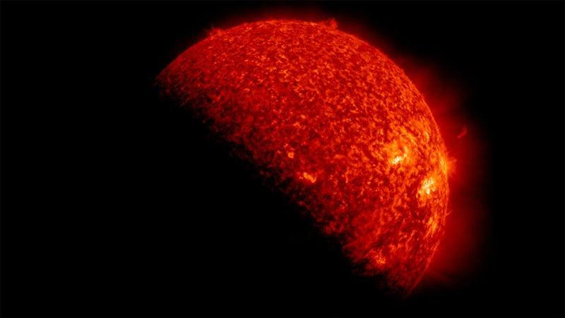 Illustration for article titled Red Marble: Unreal Portrait of the Sun Eclipsed By Earth
